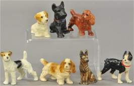 SET OF SEVEN HUBLEY CAST IRON DOG MINIATURES