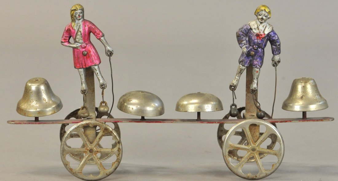 WATROUS DANCING BOY AND GIRL BELL TOY
