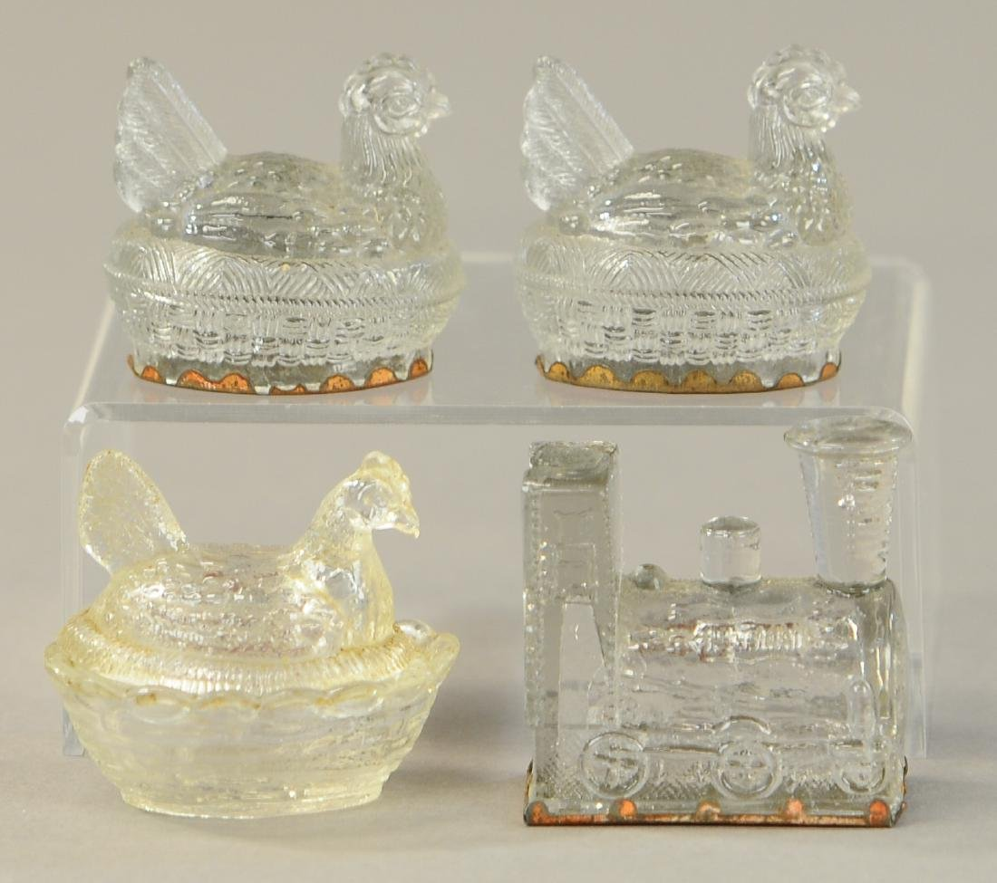 FOUR PIECE GLASS CANDY CONTAINERS