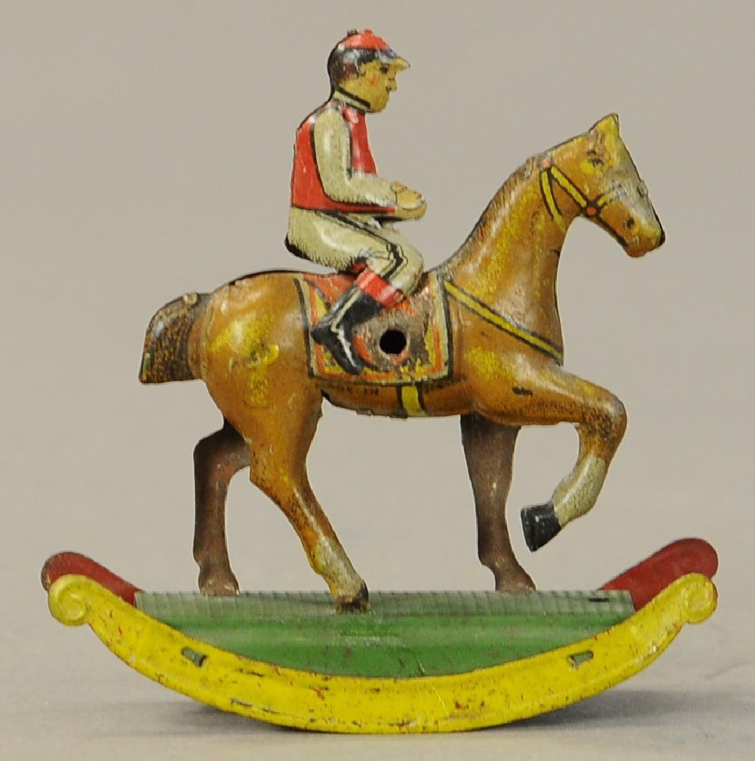 JOCKEY ON ROCKING HORSE PENNY TOY