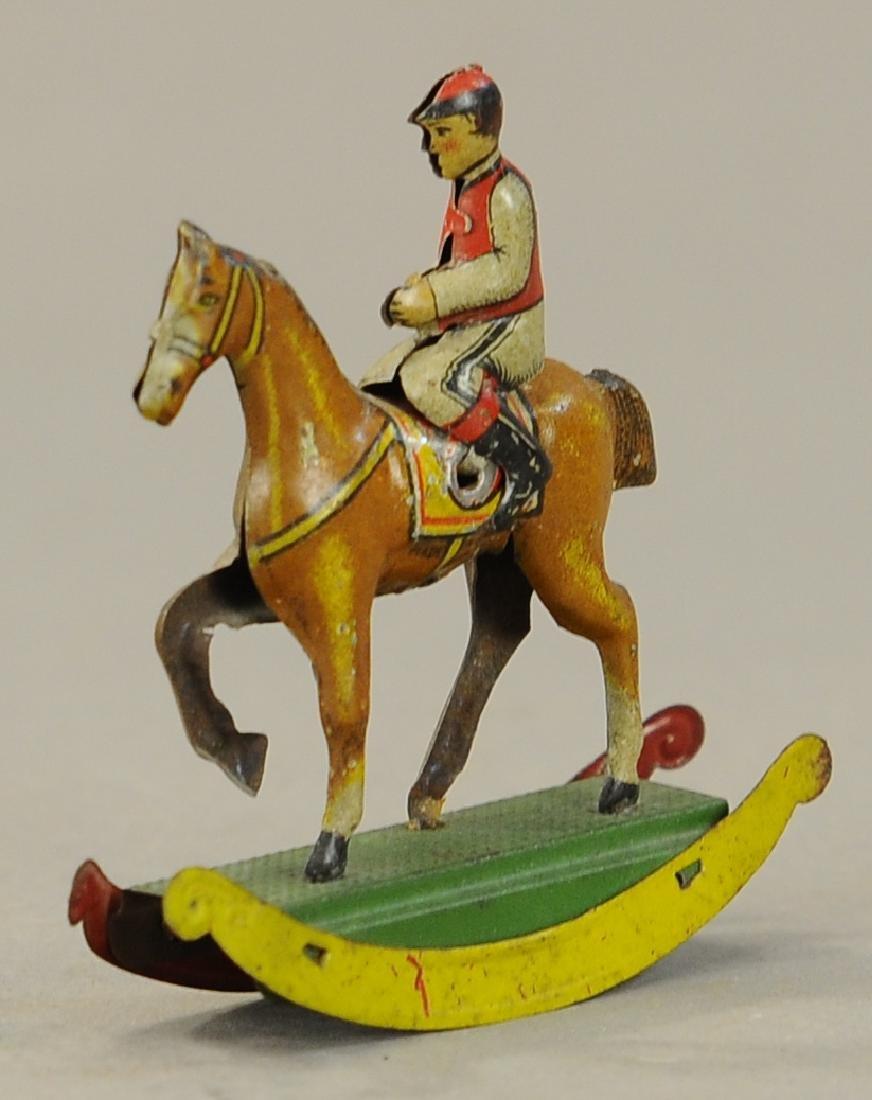 JOCKEY ON ROCKING HORSE PENNY TOY - 2