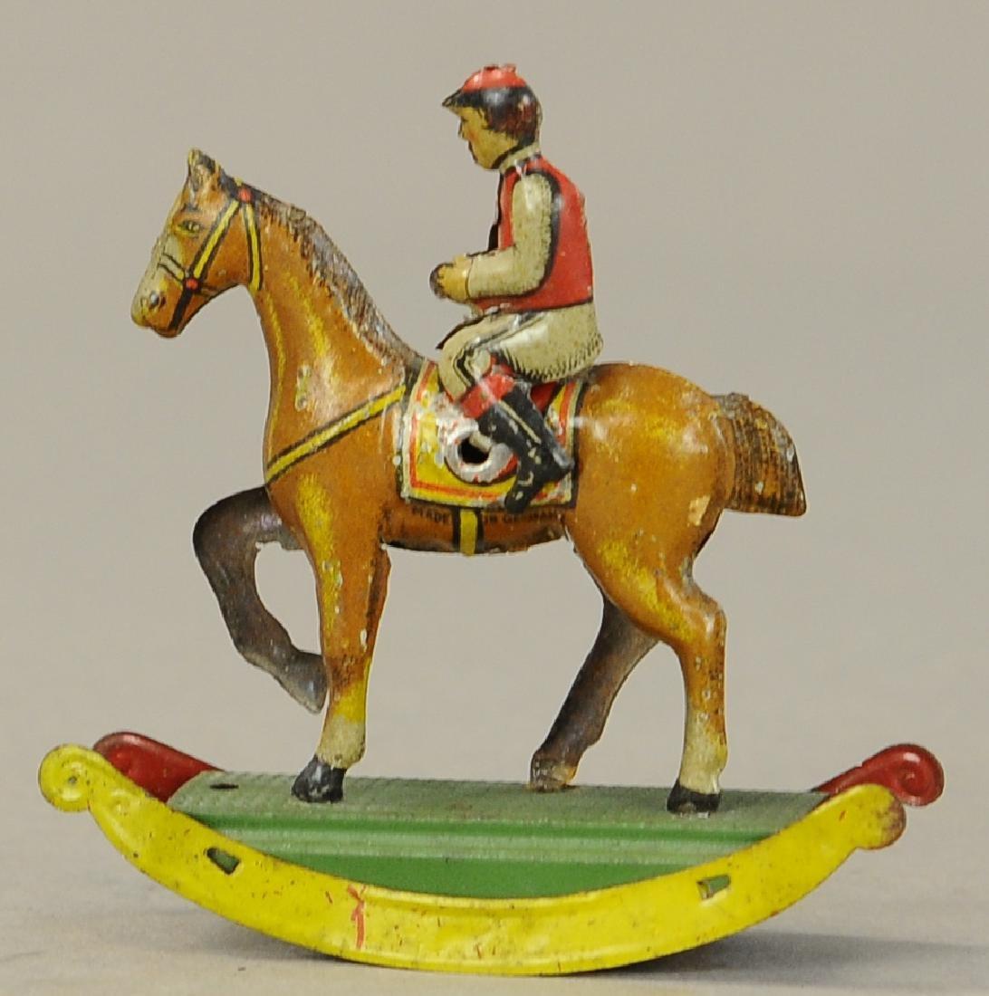 JOCKEY ON ROCKING HORSE PENNY TOY - 3