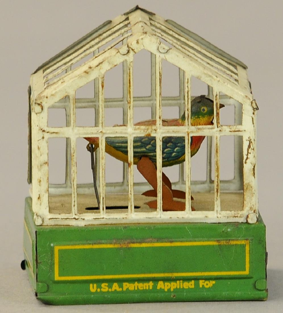 WIND-UP BIRD IN CAGE PENNY TOY