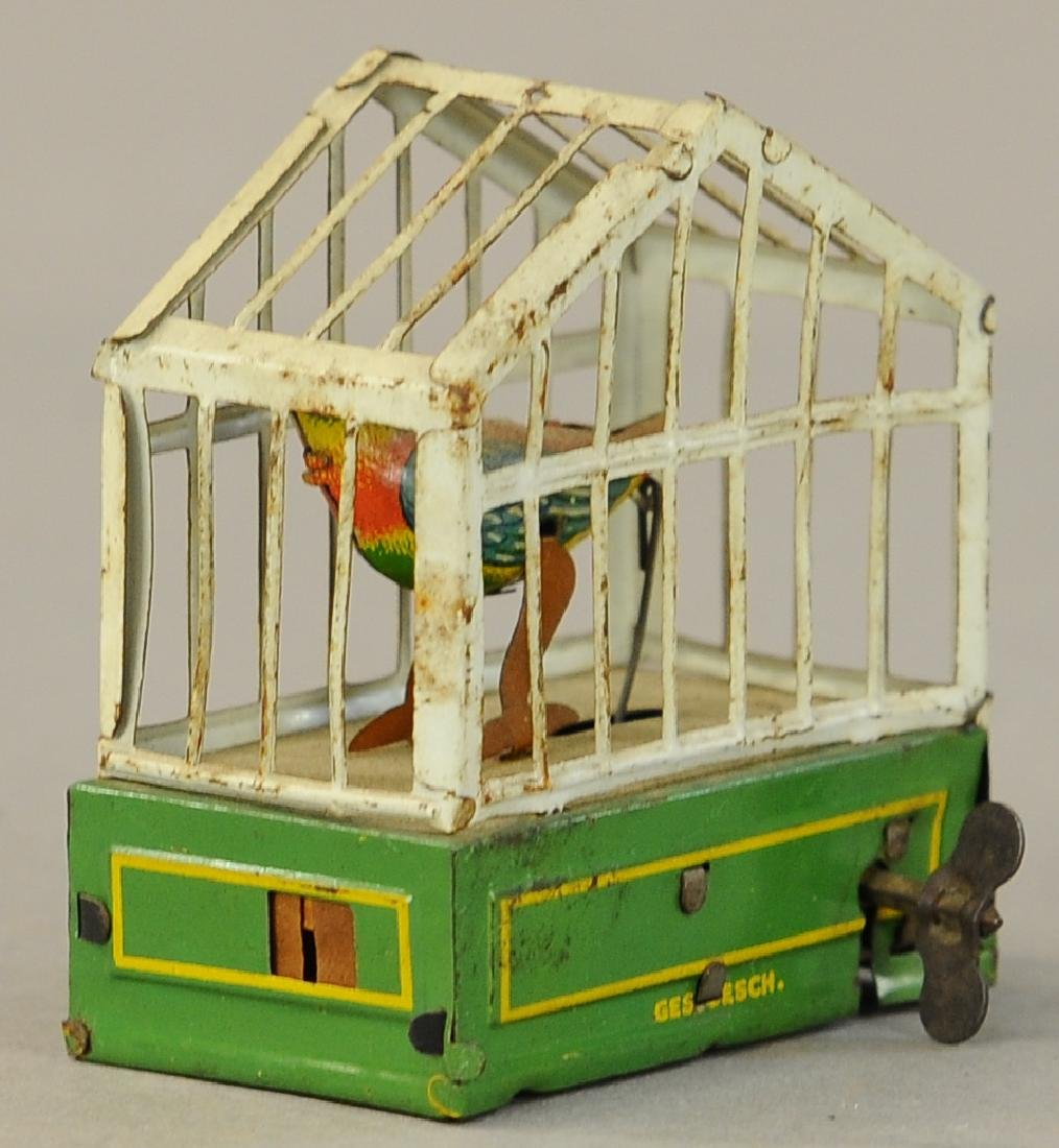 WIND-UP BIRD IN CAGE PENNY TOY - 2