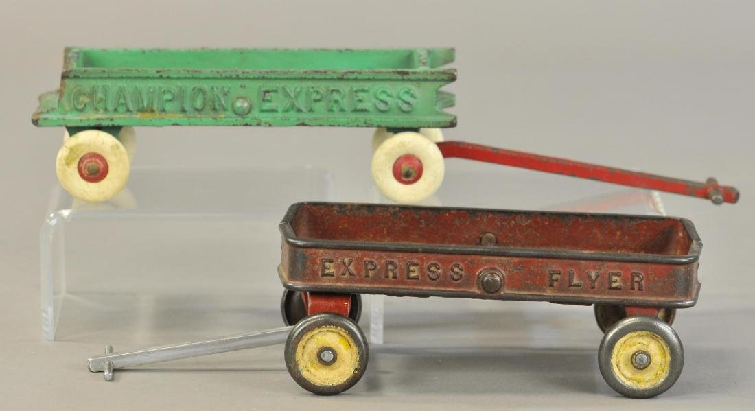 PAIR OF CAST IRON WAGONS