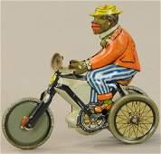 KELLERMAN DUDE ON CYCLE PENNY TOY