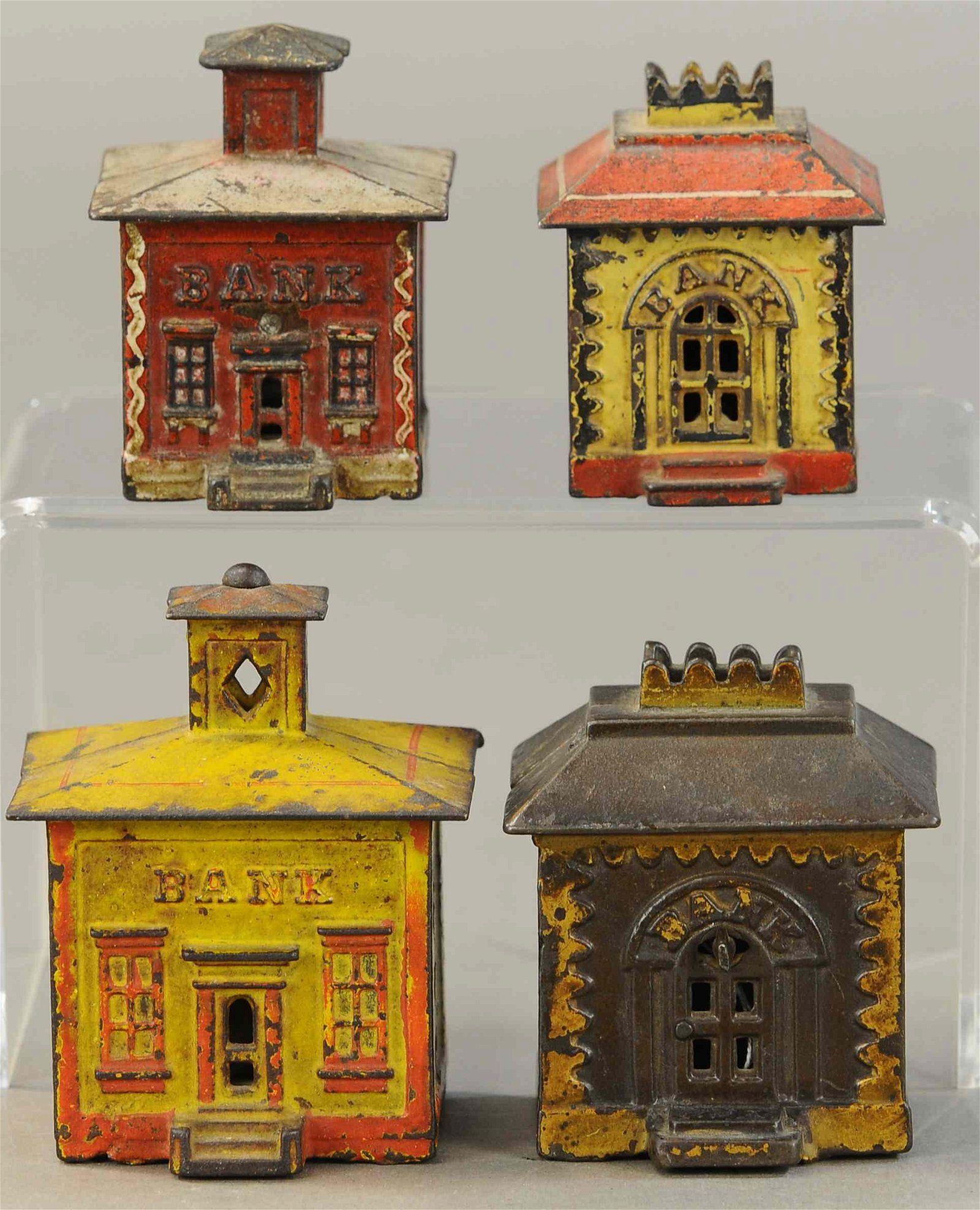 LOT OF 4 PAINTED BUILDING STILL BANKS