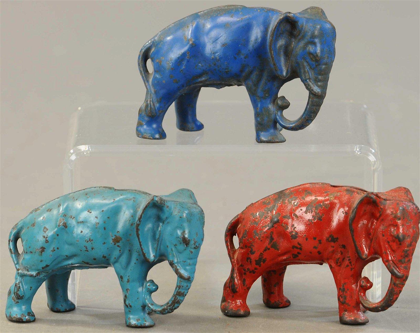 THREE PAINTED ARCADE ELEPHANT BANKS