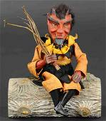 DEVIL SITTING ON LOG CANDY CONTAINER