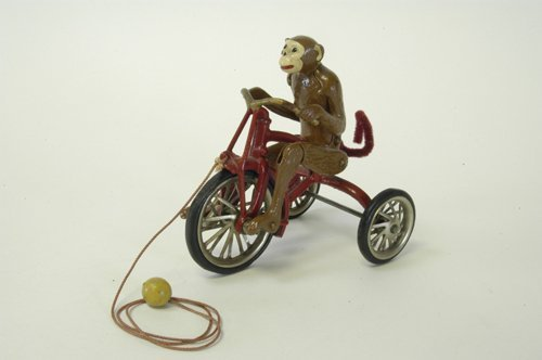 16: HUBLEY MONKEY RIDING TRICYCLE