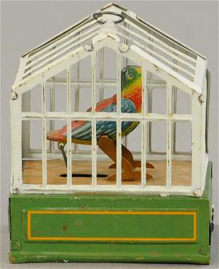 WIND-UP GERMAN BIRD CAGE PENNY TOY