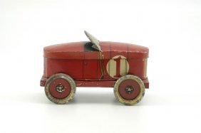1950: RACE CAR BISCUIT OR CANDY TIN