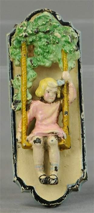 GIRL ON SWING DOORKNOCKER