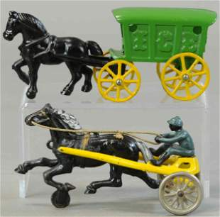 TWO SMALL HORSE DRAWN TOYS