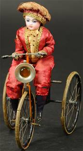FRENCH CHILD ON MECHANICAL TRIKE