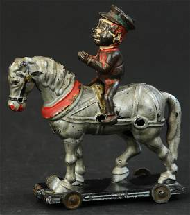 HUBLEY BROWNIE ON HORSE