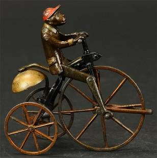 MONKEY ON TRICYCLE BELL TOY