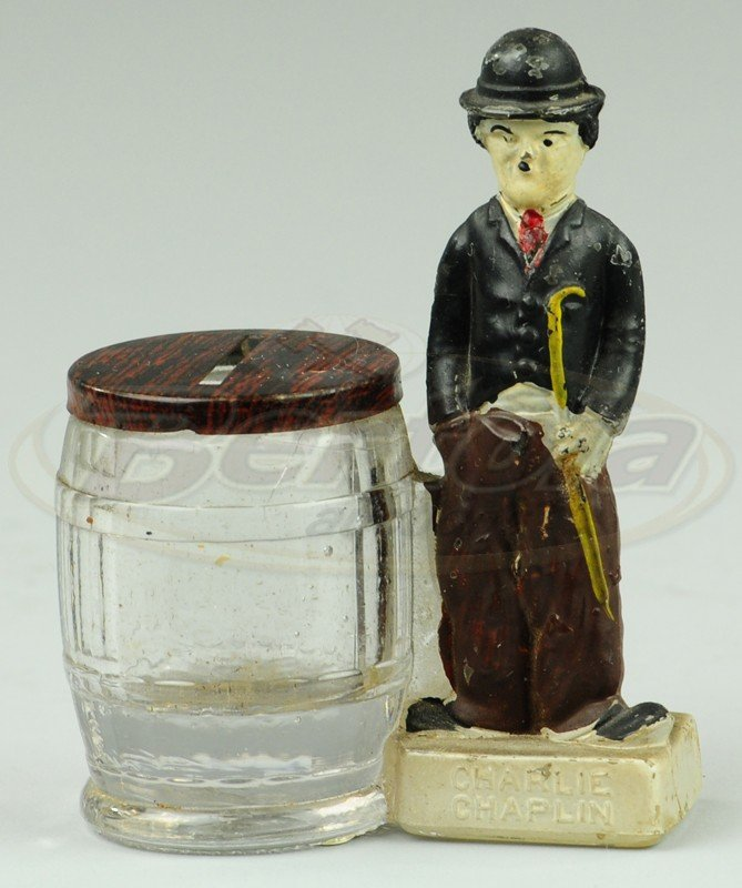 CHARLIE CHAPLIN WITH PANELED BARREL STILL BANK