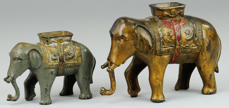TWO ELEPHANTS WITH HOWDAH