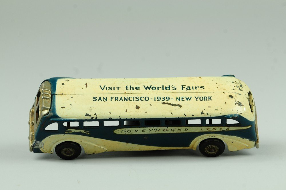 14: 1939 GREYHOUND BUS WITH WORLD'S FAIR ROOF AD