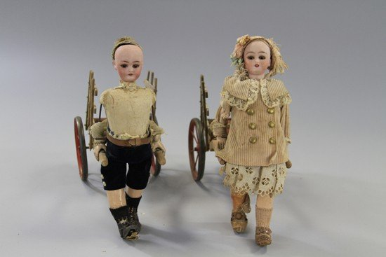 24: PAIR OF ROULLET & DECAMPS MECHANICAL DOLLS