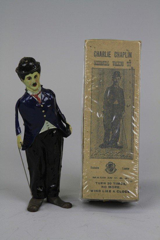 732: BOXED CHARLIE CHAPLIN WALKING FIGURE