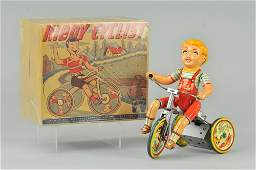 272: UNIQUE ART KIDDY CYCLIST IN ORIGINAL BOX