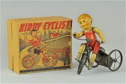 453: UNIQUE ART KIDDY CYCLIST IN ORIGINAL BOX