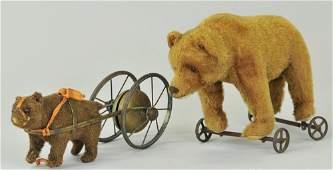 1878 TWO TEDDY BEARS ON WHEELS