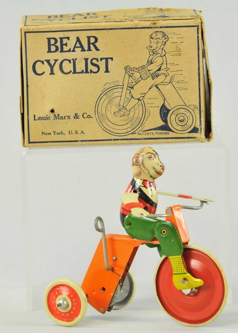 BOXED BEAR CYCLIST TOY