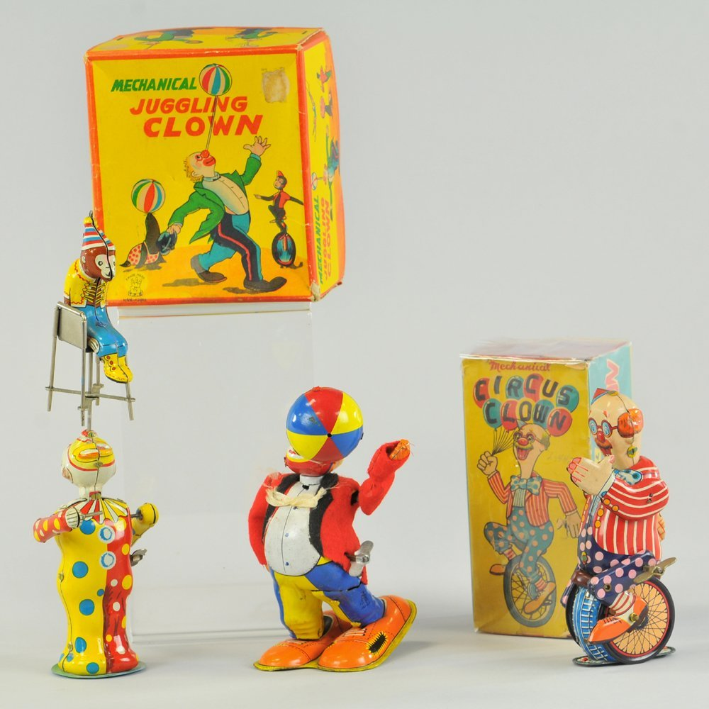 GROUPING OF TIN WIND-UP CLOWN TOYS