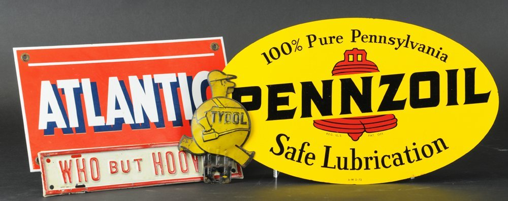 FOUR AUTOMOTIVE ADVERTISING SIGNS