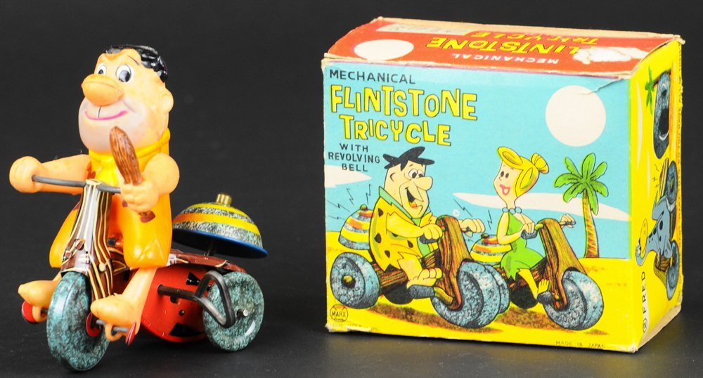 FRED FLINTSTONE ON TRICYCLE