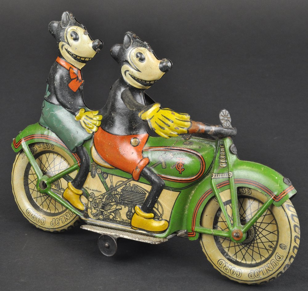 MICKEY AND MINNIE MOUSE RIDING MOTORCYCLE
