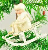 BISQUE HEAD GIRL ON SLED