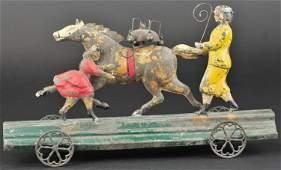 ALTHOF BERGMANN HORSE TRAINER & YOUNG GIRL BELLTOY
