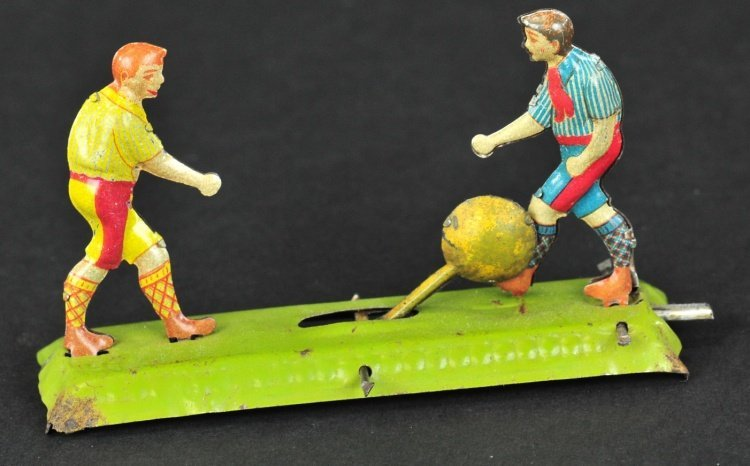 TWO SOCCER PLAYERS PENNY TOY