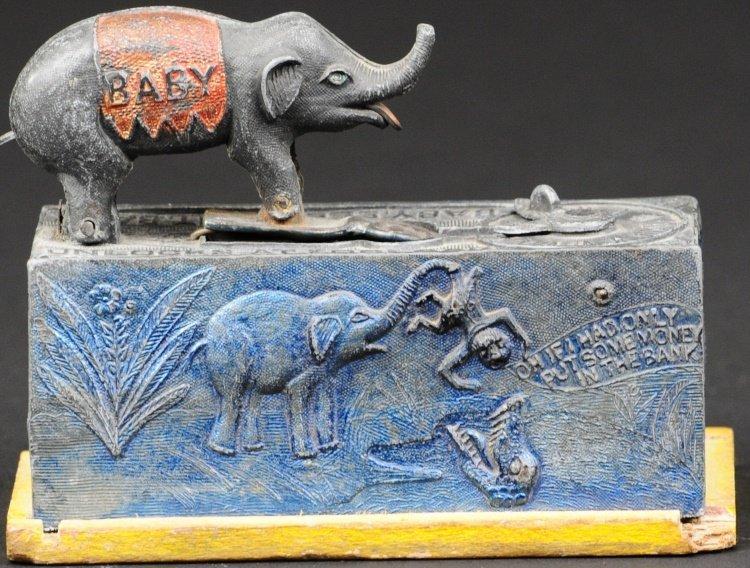 BABY ELEPHANT MECHANICAL BANK UNLOCKS TEN O'CLOCK