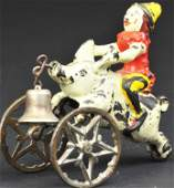 CLOWN RIDING PIG GONG BELL TOY