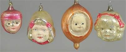 FOUR GLASS CHRISTMAS TREE ORNAMENTS