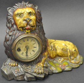 B & H Seated Lion Cast Iron Blinking Eye Clock