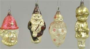 FOUR FIGURAL GLASS CHRISTMAS ORNAMENTS