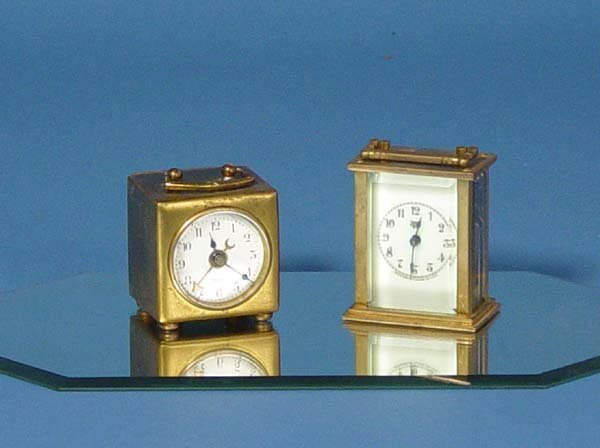 879: Two Small Carriage Clocks With Celluloid Case