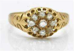 An antique 18ct gold and diamond cluster ring. The ring