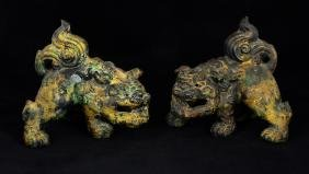 a pair of bronze lions