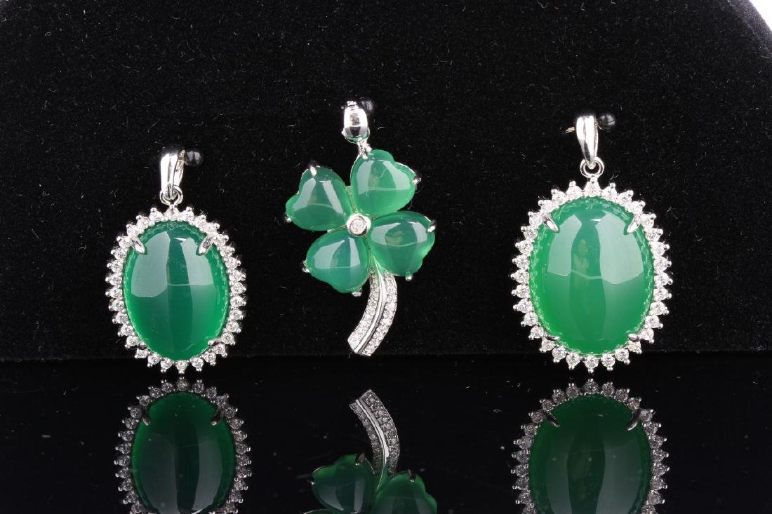 Three Chinese Jade and Silver Pendants