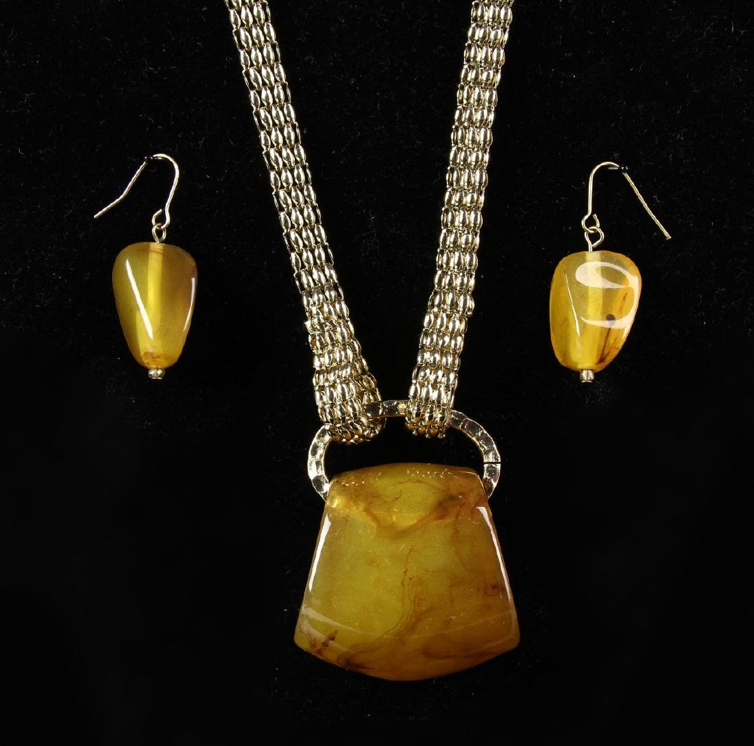 Amber Pendant and a Pair of Earrings