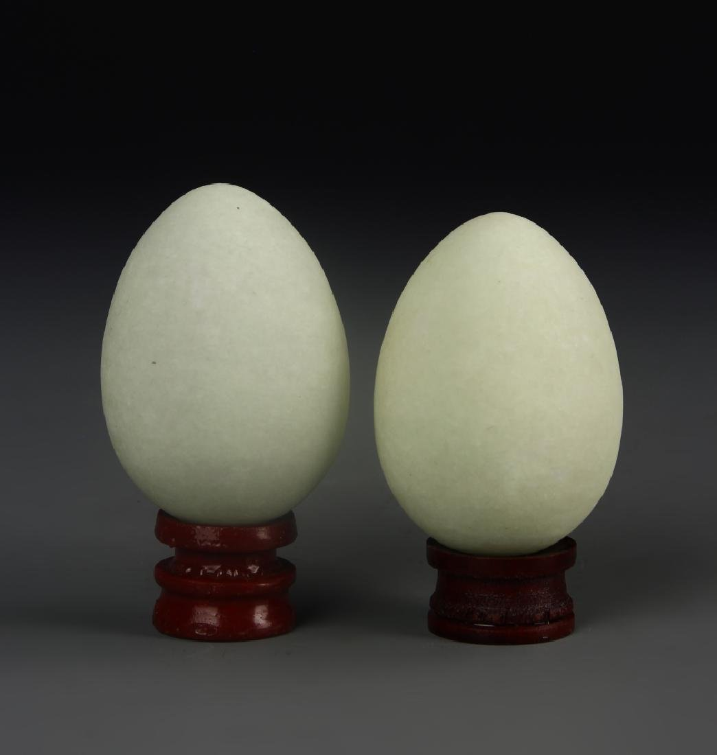 Two Stone Eggs With Base