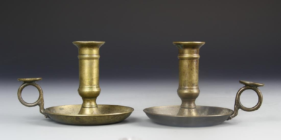 A Pair Of Metal Candle Holders