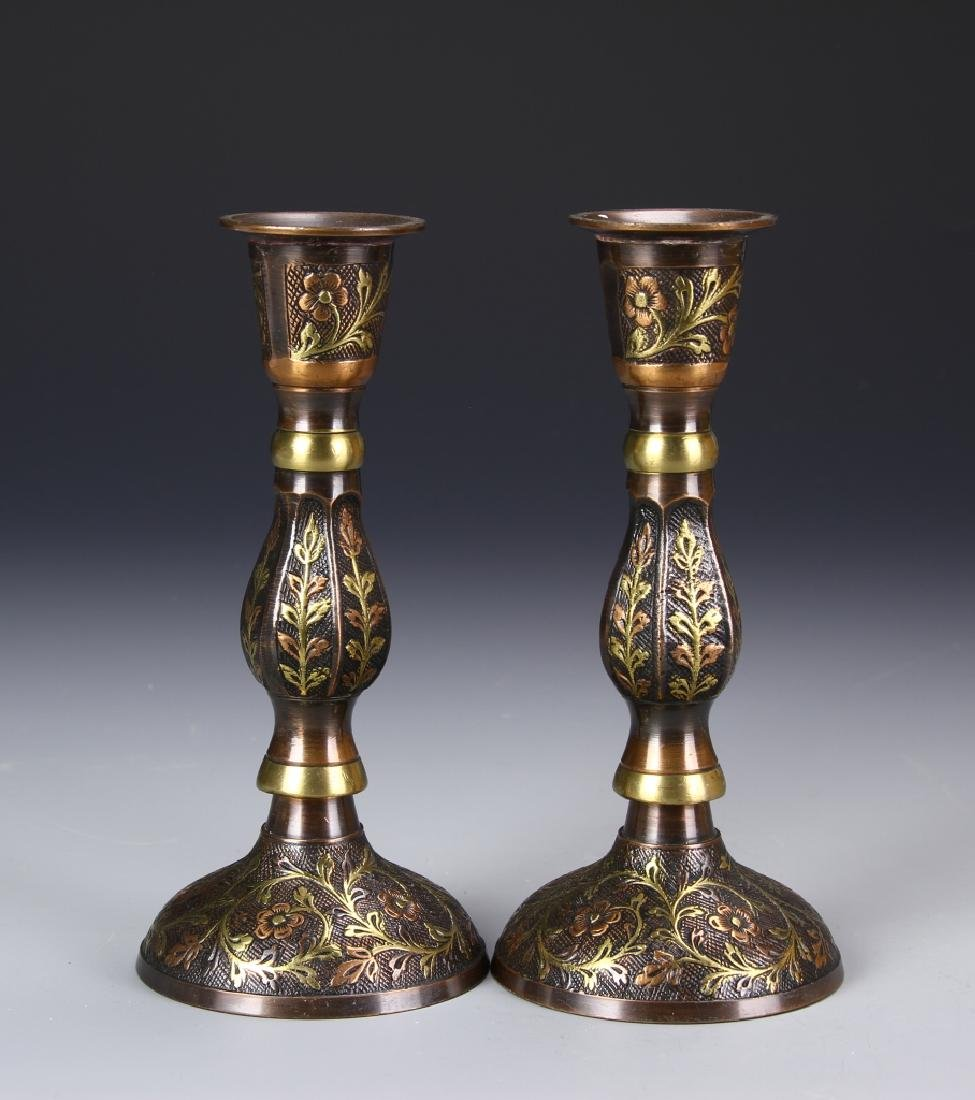 A Pair Of Metal Candle Sticks